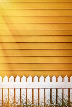 Sandra Cunningham Clapboard siding with white fence