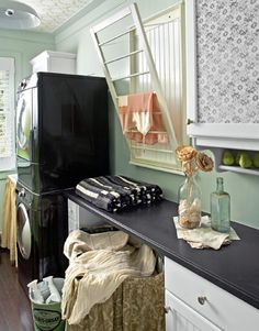 This nifty beadboard drying rack by Ballard Designs tips out to offer rungs for wet clothes without taking up floor space.