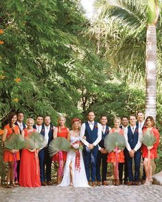 Bridesmaids dressed in pink, orange, and red, and carried palm fronds. The guys all wore navy, plus bolo ties that Dan had given them as gifts.