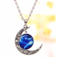 """SPECIAL Cosmic Moon Pendant Cosmic medallion dangles from decorative crescent moon. Pretty """"S"""" designed 20"""" chain. Jewelry Necklaces"""