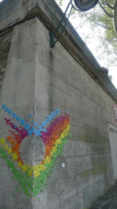 A street art installation in Paris by French artist Mademoiselle Maurice using Origami