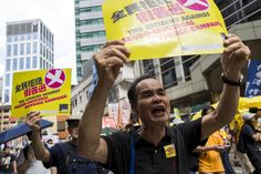 Pro-democracy protesters shout during a march to demand lawmakers reject a Beijing-vetted electoral reform package for the city's first direct chief executive election in Hong Kong, China June 14, 2015. Thousands of people took to the streets of Hong Kong on Sunday to protest against electoral reforms approved by Beijing to choose the city's next leader, the beginning of several days of demonstrations before the reforms go to a vote. REUTERS/Tyrone Siu