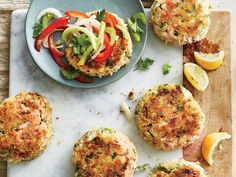 Best-Ever Crab Cakes with Green Tomato Slaw Recipe Flavored with fresh herbs lemon and a hint of hot sauce and coated with crunchy panko breadcrumbs these crab cakes truly live up to their name Fish Dishes, Seafood Dishes, Fish And Seafood, Main Dishes, Seafood Platter, Baked Crab Cakes, Crab Recipes, Recipies, Four