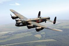 Saluting history: A Lancaster in the Battle of Britain Memorial Flight is pictured. The plane played a vital role in defeating the Nazis during the Second World War Four Seasons Art, Military Flights, Plane Photos, Lancaster Bomber, Air Force Aircraft, Battle Of Britain, Aircraft Pictures, Automotive Art, Royal Air Force