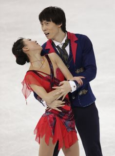 Pang Qing and Tong Jian of China compete in the pairs free skate figure skating competition at the 2014 Winter Olympics, Wednesday, Feb. 12,...