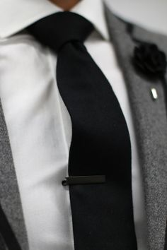 Mens Fashion - Grey blazer with black trim, white shirt, black tie, black tie clip, black lapel flower