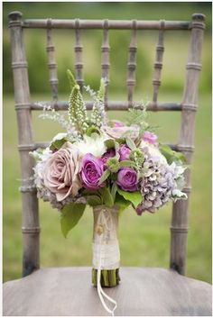 bridal bouquet, with more pink, less green and feathers