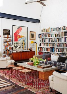 Colorful living room with library