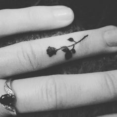 Finger black rose tattoo