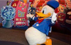 disney characters having fun | Disney Characters Donald Duck at Epcot Character Spot - OLP Travel ...