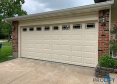 This forever-classic garage door design and color will serve these St. Louis (Oakville) Missouri homeowners well! The new door is made of premium insulated steel with a short raised panel design. The windows with grilles (Prairie) provide stylish flair while brightening the inside of the garage space too. | Project and Photo Credits: ProLift Garage Doors of St. Louis Garage Door Panels, Garage Door Design, Raised Panel, Brick And Stone, Brickwork, Steel Doors, St Louis, Home Improvement, House Design