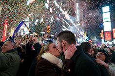 A couple kiss in Times Square for New Year 2017