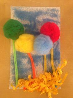 Dr. Seuss Truffula Tree craft for preschool. Sticky back collage board with pipe cleaners, Pom poms, sizzle paper and sand.