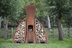 TENDU is the complete outdoor fire place, featuring modular log storage modules that neatly fit either side of the fireplace. The fire is made from double-skinned Corten steel, enhancing safety around the fireplace. The fireplace features a removable ash pan, and an optional stainless steel grill can also be specified. Tendu is also optionally available in heat-resistant black paint.