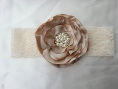 Singed satin flower on a cream lace headband, wedding headband, cream satin flower, flower girl headband, cream and lace. $14.00, via Etsy.