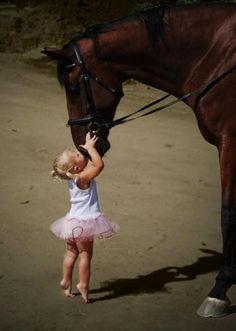Little girl giving a horse a kiss. :-)