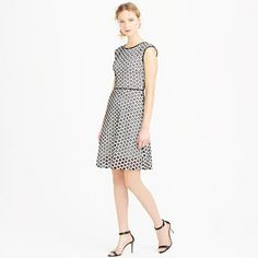 """A classic A-line silhouette in textured black-and-white eyelet turns this dress into one you can wear to the office, out on the town, running errands and, well, pretty much anywhere. It's just a question of footwear. <ul><li>A-line silhouette.</li><li>Falls above knee, 38 3/4"""" from high point of shoulder (based off size 6).</li><li>Cotton with poly embroidery, silk binding.</li><li>Back zip.</li><li>Lined.</li><li>Machine wash.</li><li>Import.</li></ul>"""