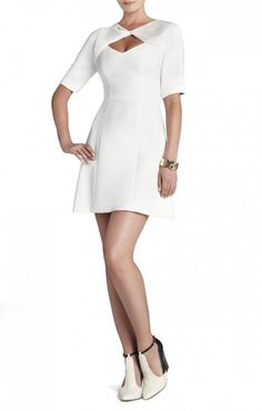 $175.00 Construct a modern, feminine look with this draped-shawl embellished dress. Round neck. Elbow-length sleeves.Keyhole cutout at bodice with sweetheart neckline. Princess seams.A-line skirt.Center back zipper closure.Self: Polyester, Rayon, Spandex. Georgette: Polyester.Dry Clean.Imported.