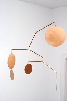 DSHOP Welcomes LaLouL by Corinne van Havre! Shown - Celeste Mobile in mirror polished copper.