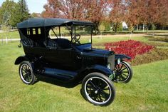 "1920 Ford Model T. | in 1914 the Model T, in the interest of streamlining production, was no longer available in red, blue, green or gray; it was now available in ""any color so long as it is black."" Electric lights were introduced in 1915, the radiator shell went from brass to black in 1916, and in 1919 an electric starter became an option on the closed cars."
