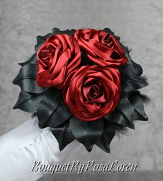 Red Bridal Bouquet; Red bridesmaids bouquet; Red satin roses and black leather. http://www.etsy.com/shop/BouquetByRosaLoren