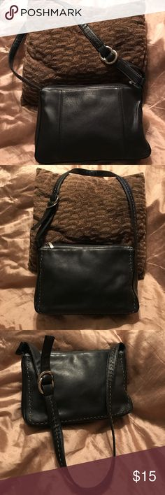 Aurielle Black leather purse w/silver buckle strap Aurielle Genuine Black leather purse w/silver buckle on the strap. There is a tan stitching design around the edge of one side of the purse and down the strap. There are two snap enclosures one on each side of the center compartment of the purse. Great condition. Aurielle Bags Shoulder Bags