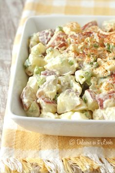 """1 ½ pounds red potatoes, scrubbed and cut into ¾"""" cubes 1 1/2 teaspoons kosher salt, divided 4 scallions/green onions (green parts only!), thinly sliced 2 hard-cooked eggs, peeled and chopped* 1 rib celery, finely diced 1/2 cup light mayonnaise (I use Hellmann's) 1/4 cup low-fat, plain kefir (I use Lifeway) 1 1/2 teaspoons Dijon mustard 1/4 teaspoon freshly ground black pepper paprika"""