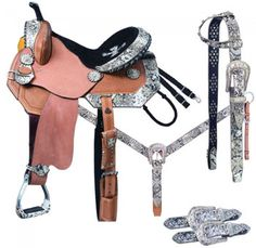 The Saddle Package includes barrel saddle; matching browband headstall and breast collar; and shaped leather spur straps. Available in light oil and white snake print. Barrel Racing Saddles, Barrel Saddle, Barrel Racing Horses, Barrel Horse, Western Horse Tack, My Horse, Western Saddles, Horse Tips, Horse Barns