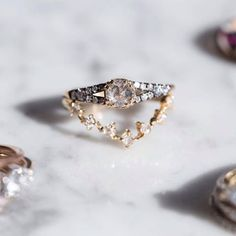 An unexpected pairing, the very best sort; let us always delight in surprises. The Devotion Ring perched atop a Curved Snow Queen. Both at Catbird and catbirdnyc.com.