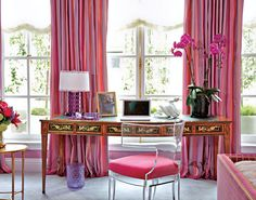 Jamie Drake Kips Bay Showhouse room in fuchsia pink. We love the pink draperies and lucite desk chair with pink seat cushion.
