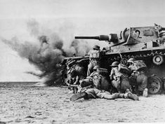 2 November 1942, Second Battle of El Alamein. Allied infantry take cover behind a disabled German Panzer.