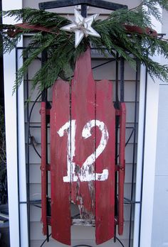Down to Earth Style: Rustic Christmas Porch, red antique sled, numbered, with pine branches Merry Christmas, Christmas Blocks, Christmas Porch, Primitive Christmas, Christmas Love, Country Christmas, All Things Christmas, Winter Christmas, Vintage Christmas
