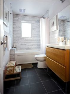 Modern Industrial Bathrooms with Wood tones, Pops of Bright White , and Moody Black Tones. Black, Wood, and White Bathrooms. Modern Industrial, Industrial Bathroom, White Bathrooms, Toilet, Bright, Black Wood, Bathtub, Doors, Green