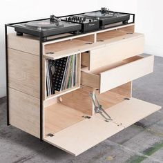 NEW WORK 'Selectors Cabinet'  This DJ furniture piece is constructed with a steel frame and modular wooden cabinets. Creating a perfect balance between esthetics and functionality was the main goal. Both turntables and CDJ's will fit. Being compact and classy, the cabinet blends in perfectly with your interior. The Selectors Cabinet can be placed in for example living rooms, shops, galleries or bars. There is space to store your records in three compartments. Monitor speaker stands come…