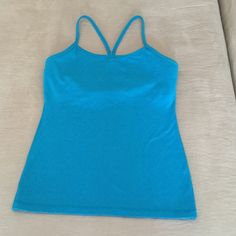 Lululemon Flow Y Workout Top Lululemon Flow Y Workout Top. Size 8. Beautiful heathered blue. Inside pockets for bra padding (not included). VERY GOOD CONDITION !! No trades lululemon athletica Tops Tank Tops