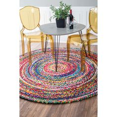 Quality meets value in this beautiful modern area rug. Handmade with 100% cotton, this plush area rug will enhance any home decor.