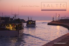 Fishermen sailings for fishing time - Cesenatico, ITALY 5.30 am