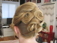 A stunning curly french twist.