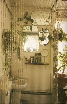 Bathroom Beaded curtain divider! An elegant, chic and practical use for beaded curtains.