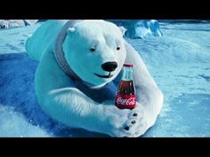 """Coca Cola releases their """"polar bear"""" commercial annually during the winter season. In the commericals, polar bears are cleverly portrayed as loving the Coca Cola beverage. The polar bear advertisement first appeared in France in Coca Cola Santa, Coca Cola Christmas, Coca Cola Polar Bear, Christmas Adverts, Coca Cola Vintage, Vintage Ads, Super Bowl, Coke Ad, Pepsi Cola"""