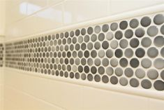 white subway tile with a stripe of penny tile