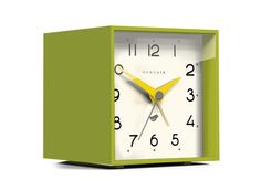 Contemporary cubed alarm clock in bold colors and silicone finish. Retro alarm clock in lime green with silicone finish. Metal hands and acrylic lens. Size: HW