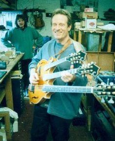 John Paul Jones with a cool triple neck- mandolin, mandola, and bass mando.