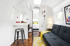 The thoughtfully designed kitchen in the Deluxe Queen Suite—a 31-foot-long 1964 trailer—features just enough nooks and crannies to tuck away essentials. And yes, that sofa pulls out into a double bed.)