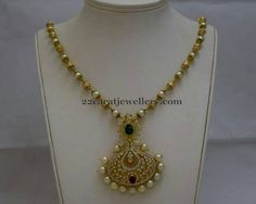 Jewellery Designs: Gold and Pearl Set with Diamond Locket