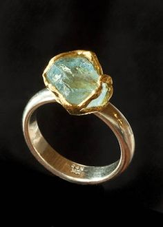 Custom natural aquamarine gem nested in a 24k gold setting on a 12k white gold ring - great for a lover of all things organic