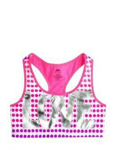 a1b08bb682 Justice is your one-stop-shop for on-trend styles in tween girls clothing    accessories. Shop our Dot Graphic Racerback Sports Bra.