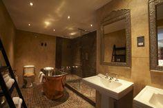 Contemporary Suite bathroom, free standing Copper Bath, Walk-through rainforest power shower, double sinks, contemporary design