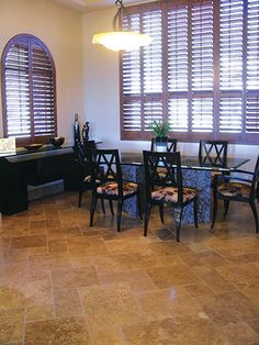 A distinct Authentic Durango Stone™ tile dining room floor awaits. Call 602-438-1001 to check availability and pricing.
