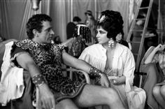 In costume, Richard Burton and Liz Taylor share a look on the set of Cleopatra. The two passionate, larger-than-life stars would marry not once, but twice  1962